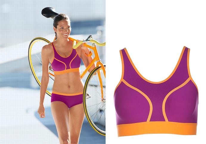 triumph triaction fusion star sports bra on woman with bike